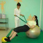 Gumb na stran vaje za hrbet in trebuh ter kinezioterapija